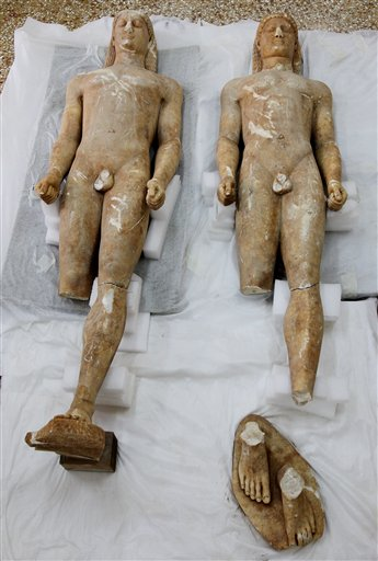 Two illegally excavated ancient male  statues recovered from antiquities smugglers in southern Greece are displayed at the National Archaeological Museum in Athens, Tuesday, May 18, 2010. Greek authorities say two farmers have been arrested for allegedly illicitly excavating the statues, which date between 550 and 520 BC, and trying to sell them to a foreign buyer for euros 10 million. Police are seeking a third suspect. (AP Photo/Thanassis Stavrakis)