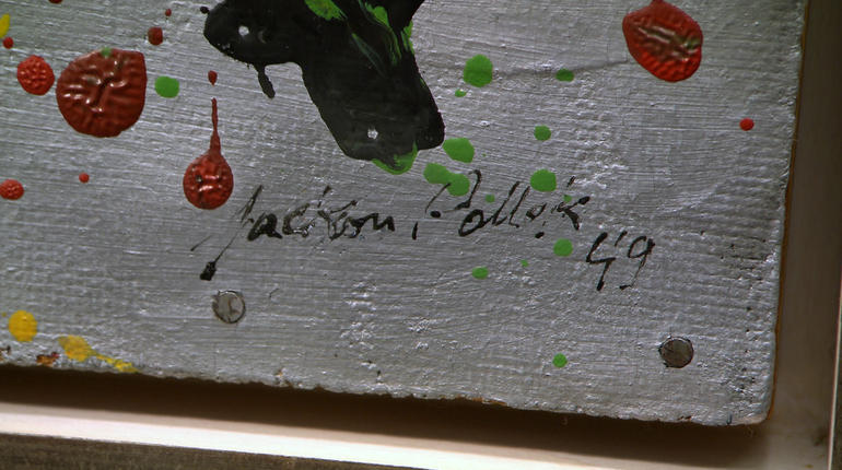 This forged work forgot to spell Jackson Pollock's last name with a 'c'